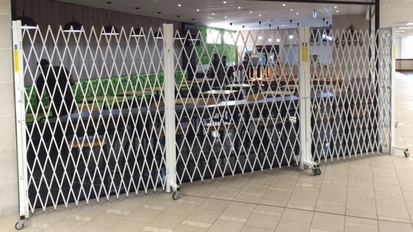 AUSSIE EXPANDABLE SECURITY DOORS FOR INTERNATIONAL AIRPORT CONTRACTS