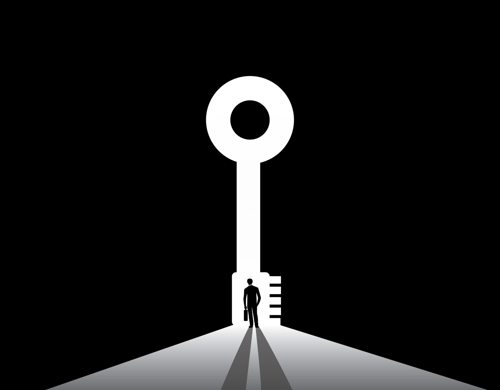 A silhouetted man stands beneath a large key