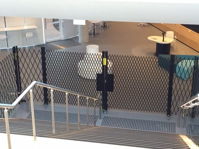 EXTENDABLE SAFETY BARRIERS AT GREEN SQUARE LIBRARY ARE BCA EGRESS COMPLIANT