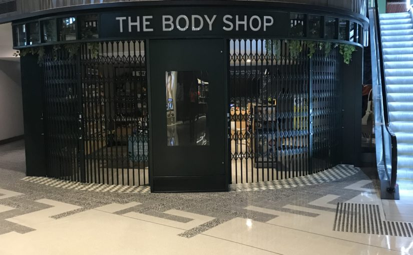 EDGY FOLDING SECURITY SHUTTERS FOR THE BODY SHOP