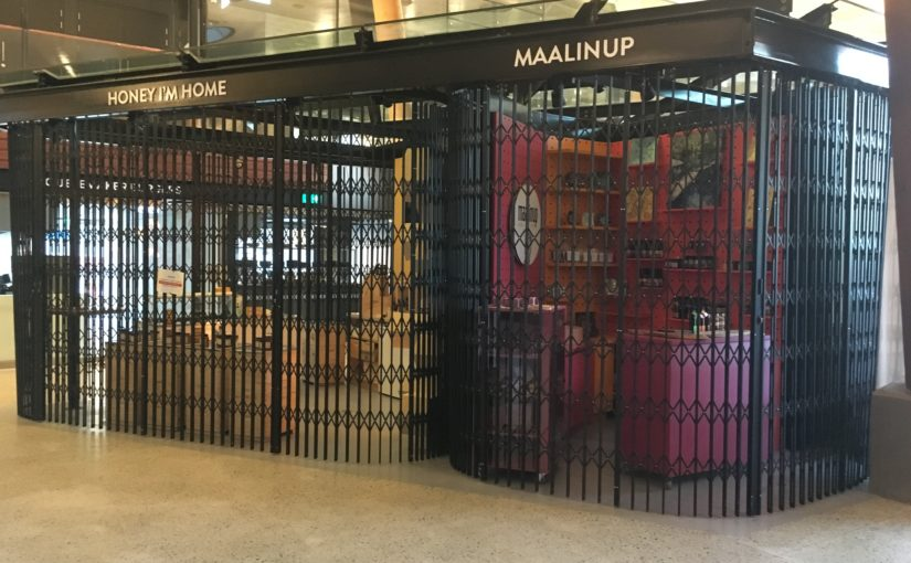 CURVED TRELLIS SECURITY DOORS SECURE TENANCIES WITHIN YAGAN SQUARE, PERTH