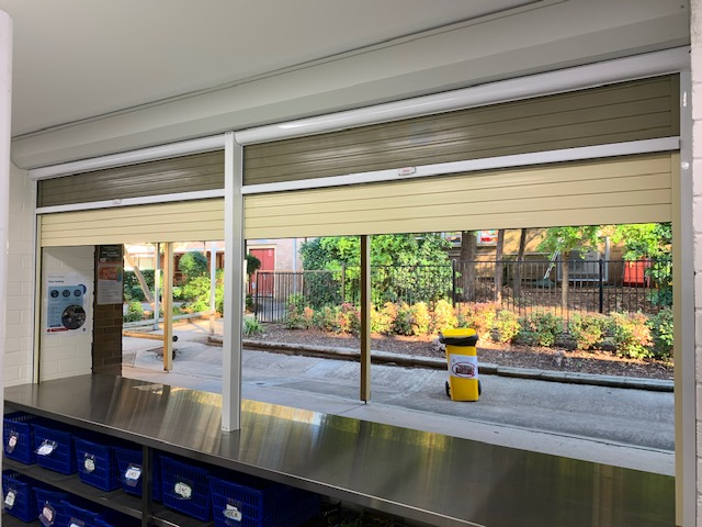 COMMERCIAL ROLLER SHUTTERS WITH INNOVATIVE NEW SPRING OPERATED ROLL UP FLYSCREENS